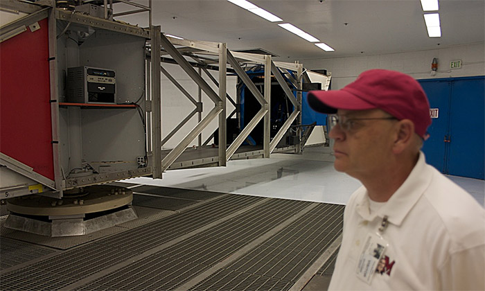 Citizens in Space astronaut candidate Steve Heck inspects centrifuge