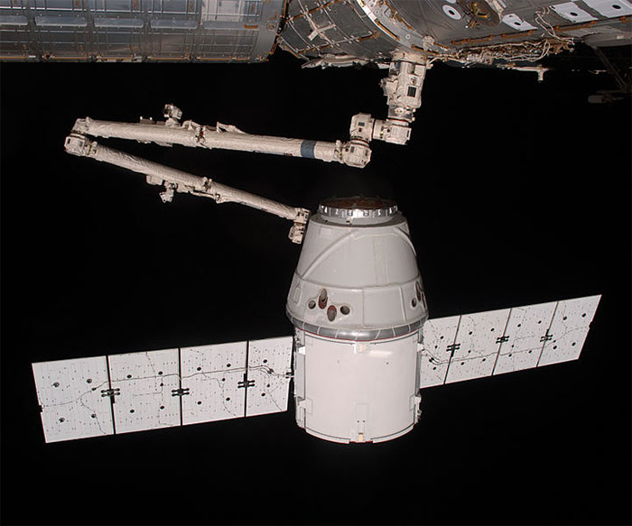 SpaceX Dragon capsule berthing at the International Space Station