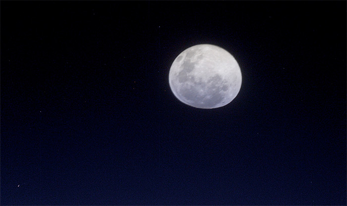 Moon, photographed from International Space Station, flattened by atmospheric refraction
