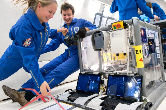 Naomi Murdoch and Thomas-Louis de Lophem in zero gravity alongside the experiment (Credit: A. Le Floc'h, ESA)