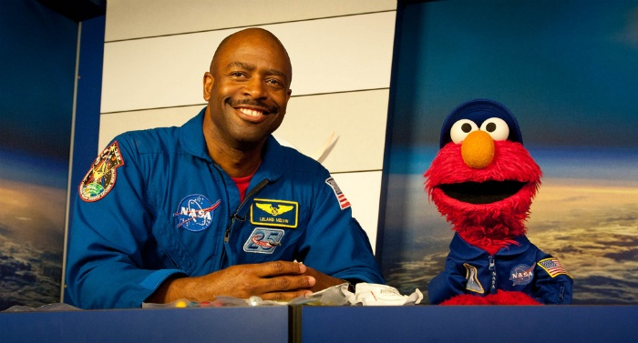 NASA Associate Administrator Leland Melvin and Sesame Street's Elmo